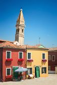 image of oblique  - The colored houses near the old oblique Church Tower  - JPG