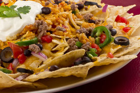 foto of jalapeno  - Mexican nachos with sour cream black olives ground beef black beans tomatoes shredded cheese jalapenos rice and cilantro