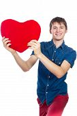 Handsome brunette mans holding a red heart, isolated on white background
