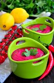 Cold summer Beets cream soup on the wooden background