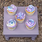 pink Cup-cakes on a wooden tray