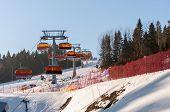 Ski Slope And Modern Chair Ski Lift
