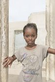 Thiaroye, Senegal, Africa - July 30, 2014: Unidentified girl standing at the door of her house