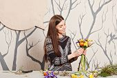 Pretty Florist Making Bouquet From Spring Flowers