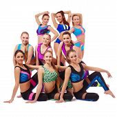 Charming young fitness girls posing at camera