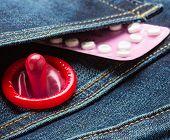 Pills And Condom In Denim Pocket.