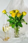 Yellow Roses and glasses of wine