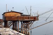 Stilt House By The Sea And Fishing Nets Of Fishermen