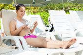 Woman Using Digital Tablet At Resort