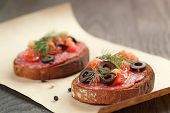 open rye sandwich with salami and vegetables