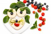 cheesecakes as animal face shape decorated by berries and mint