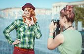 Two Beautiful Hipster Girls Taking Pictures On Film Camera