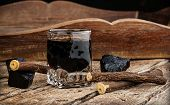 image of licorice  - Licorice liqueur with pure blocks and roots on wooden table - JPG