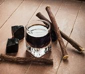 pic of licorice  - Licorice liqueur with pure blocks and roots on wooden table - JPG