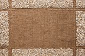 picture of sackcloth  - Beautiful frame with sunflower seeds on sackcloth with place for your text graphics - JPG