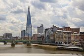 LONDON, UK - JUNE 30, 2014: Shard of glass on the river Thames, office and residential building in t