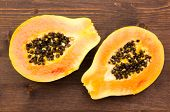 Papaya on wood from above
