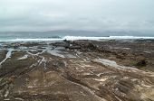 pic of naturist  - Gran Canaria El Confital beach at the edge of Las Palmas eroded sandstone patterns - JPG