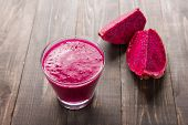 image of dragon fruit  - Red dragon fruit smoothie on wooden background  - JPG