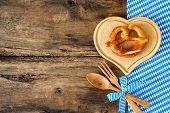 picture of pretzels  - Oktoberfest festival background with pretzel on cutting board - JPG
