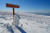picture of serbia  - Wooden signboard on snow showing direction to Mountain Cart ski resort Kopaonik Serbia - JPG