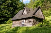 stock photo of abandoned house  - An old abandoned wooden house in Polish mountains during sunset - JPG