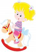foto of horse girl  - Happy little girl riding a toy horse - JPG