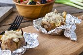 foto of baked potato  - Baked potato with mushrooms cream and cheese - JPG
