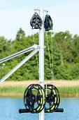 pic of  rig  - Black fishing rig with bright yellow fishing line attached - JPG