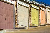 foto of roller door  - Colorful garage doors in a raw  - JPG