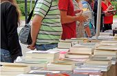 picture of stall  - Readers choose a book in a book stall - JPG