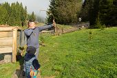pic of shoot out  - Father and son shoot arrows at a target - JPG