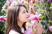 foto of magnolia  - beautiful dreamy girl holding a branch of the magnolia - JPG