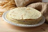 stock photo of whole-wheat  - Stack of homemade whole wheat flour tortilla on plate - JPG