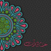 pic of arabic calligraphy  - Beautiful floral design decorated greeting card with Arabic Islamic calligraphy of text Eid Mubarak for famous festival of Muslim community - JPG