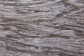 stock photo of woodgrain  - Closeup of red cedar plank showing knot texture and natural woodgrain pattern as wood background - JPG