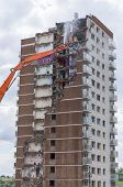 stock photo of deprivation  - Construction work demolishing high rise flats signifying housing and regeneration - JPG