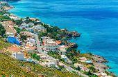 stock photo of greek-island  - Typical Greek houses on the coast - JPG