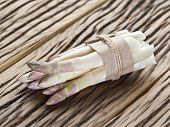 image of white asparagus  - Shoots of white asparagus on the old wooden table - JPG
