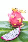 stock photo of dragon fruit  - Dragon fruit on banana leaf against white background - JPG