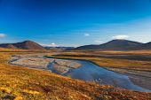 foto of chukotka  - Colorful autumn tundra and river Amguema Chukotka - JPG