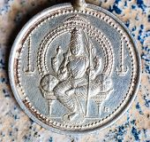 picture of goddess  - A silver pendent or coin depicting Goddess Parvati - JPG
