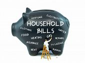 stock photo of household  - A piggy bank with household cost related words on the side - JPG