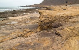 picture of nudist beach  - Gran Canaria El Confital beach at the edge of Las Palmas eroded sandstone patterns - JPG