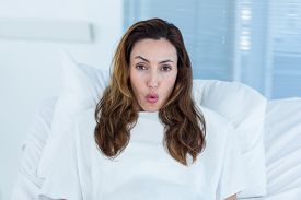 image of hospital gown  - Pregnant woman on a hospital bed in hospital room - JPG