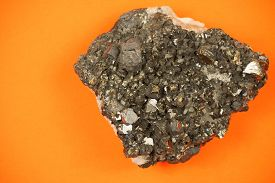 image of ore lead  - Picture of a whole piece of black lead ore with irregular texture - JPG