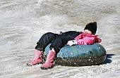Girl Tubing In The Snow