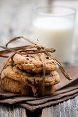 image of chocolate-chip  - Pile of delicious chocolate chip cookies on table - JPG