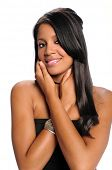 image of female model  - Portrait of young African American woman with hands on face - JPG