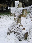 Cross Gravestone With A Lot Of Snow